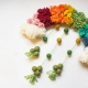 diy rainbow pom pom wreath